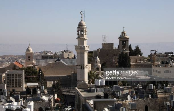 A general view of the West Bank biblical city of Bethlehem on December 19 2019 with the minaret of a mosque and the Church of the Nativity the site...