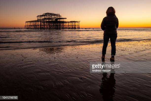 A general view of the West Pier seen at sunset and low tide on Brighton beach on September 26 2018 in Brighton England