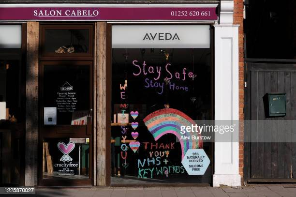 A general view of the window of a hairdressers which displays a message of support for NHS and key workers on May 19 2020 in Fleet England The...