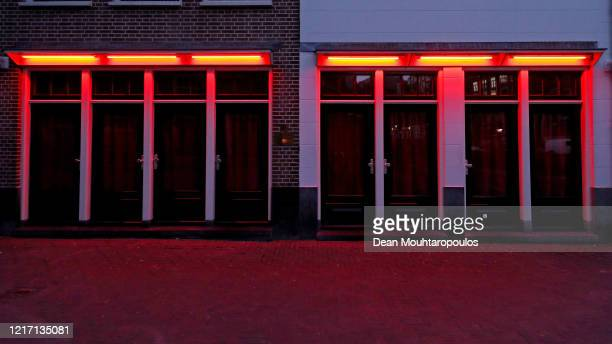 A general view of the 'Windows' in the Red Light District which comes from the red neon lights that highlight the windows where prostitution is legal...
