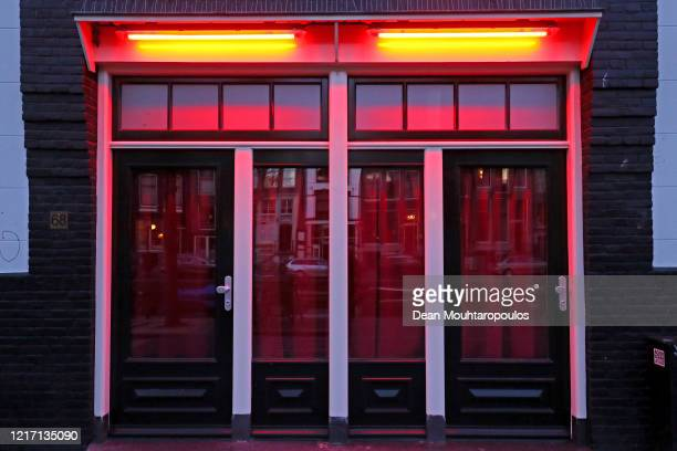 """General view of the 'Windows' in the """"Red Light District"""" which comes from the red neon lights that highlight the windows where prostitution is..."""