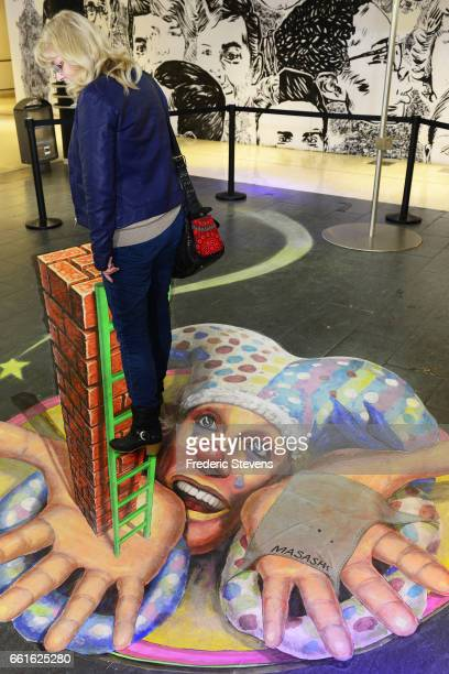 A general view of the work of Japan streetartist Masashi Hattori displayed in the commercial center of Bercy 2 near for the Street Art Anamorphose...