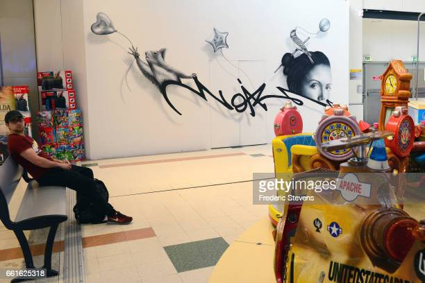 A general view of the work of streetartist Noir Artist displayed in the commercial center of Bercy 2 near for the Street Art Anamorphose Project...