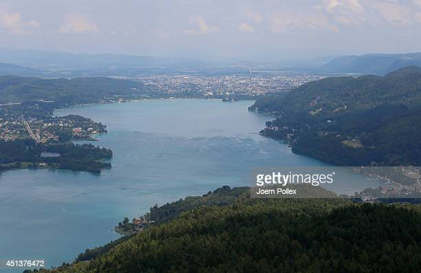General view of the Worthersee lake with the towns of Poertschach and Klagenfurt in the Carinthia region ahead of the 2014 Ironman Austria on June...