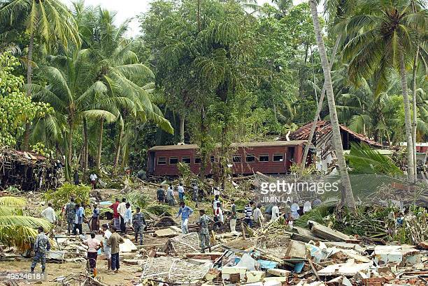 A general view of the wreckage of houses and train carriages after tidal waves washed away the train in Sinigame near the tourist town of Hikaduwa on...