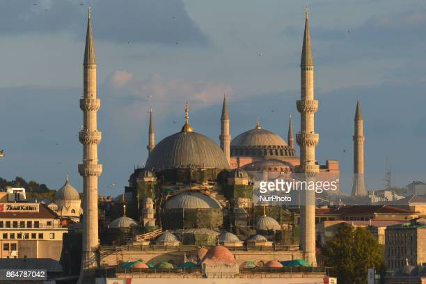 A general view of the Yeni Cami meaning New Mosque and Hagia Sophia museum a former Greek Orthodox Christian patriarchal basilica seen at sunset On...