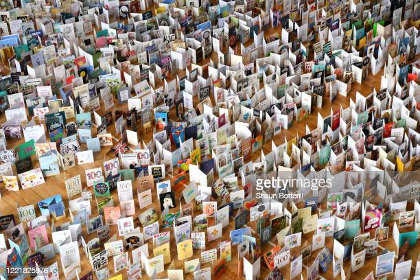 A general view of thousands of birthday cards sent to Captain Tom Moore for his 100th birthday on April 30th are pictured displayed in the Hall of...