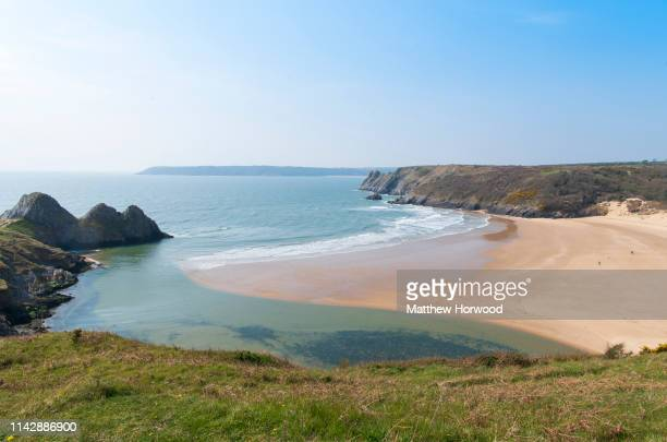 A general view of Three Cliffs Bay on the south coast of the Gower Peninsula on a clear sunny day on April 12 2019 in Swansea United Kingdom