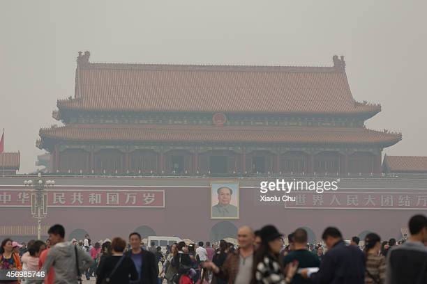 A general view of Tiananmen Square in heavy smog on October 10 2014 China's National Meteorological Center issued a yellow alert on Friday as heavy...