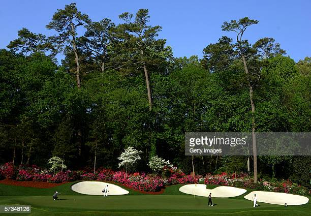 A general view of Tiger Woods lining up a putt on the 13th hole during the rain delayed 3rd Round of The Masters at the Augusta National Golf Club on...