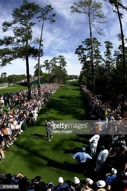 A general view of Tiger Woods teeing off the 18th hole during practice for The Masters at the Augusta National Golf Club on April 5 2006 in Augusta...