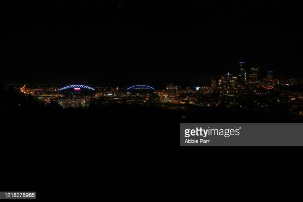 A general view of TMobile Park and CenturyLink Field lit up in blue to honor essential workers during the coronavirus outbreak on April 09 2020 in...