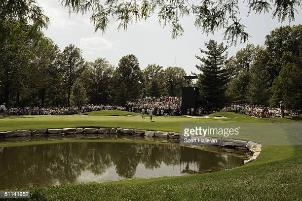 A general view of Tom Kite putting on the sixth green during the final round of the 25th US Senior Open at Bellerive Country Club on August 1 2004 in...