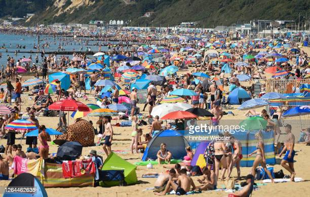 General view of tourists on the beach on August 07, 2020 in Bournemouth, England. Parts of England are enjoying a three-day heatwave with...