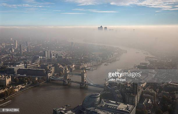 A general view of Tower Bridge and the city through the fog seen from The View From The Shard on October 31 2016 in London England