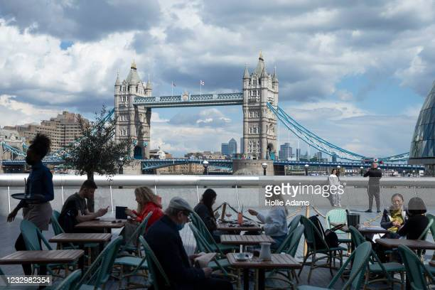 General view of Tower Bridge from the outdoor dining area at Tavolino Bar & Kitchen on May 19, 2021 in London, England. Although indoor drinking and...