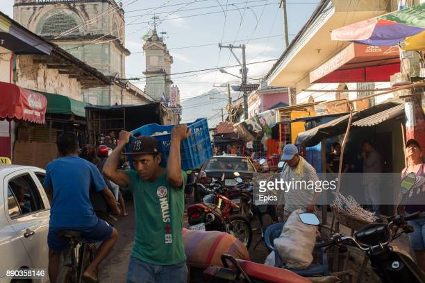 A general view of traffic and traders in a busy street leading to the market in Granada Nicaragua