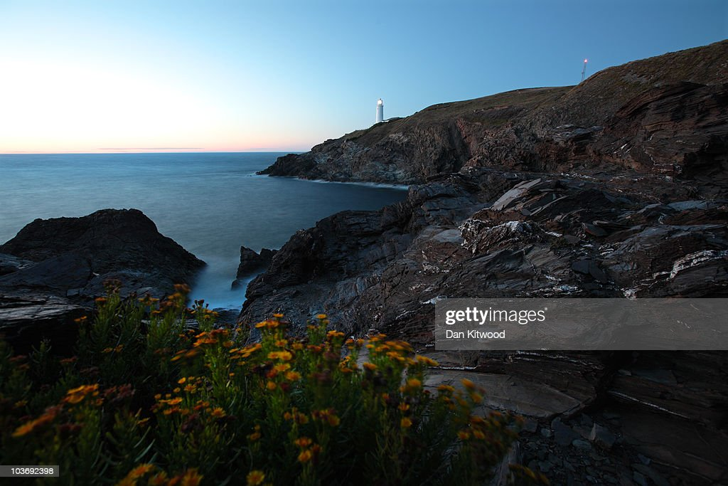A general view of Trevose Head lighthouse at sunset on August 27, 2010 in Trevose, England. The 19th century lighthouse stands a short distance west of Padstow, on North Cornwall's dramatic coastline and plays the role of helping to guide ships into the Bristol Channel.