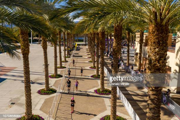 General view of triathletes running through he palm trees at the Indian Wells Tennis Center during the IRONMAN 703 Indian Wells La Quinta on December...