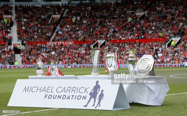 A general view of trophies on display on the pitch ahead of Michael Carrick's Testimonial match at Old Trafford Manchester PRESS ASSOCIATION Photo...