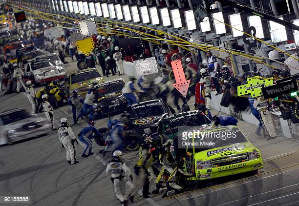 A general view of trucks in pit lane during the NASCAR Camping World Truck Series EnjoyIllinoiscom 225 on August 28 2009 at the Chicagoland Speedway...