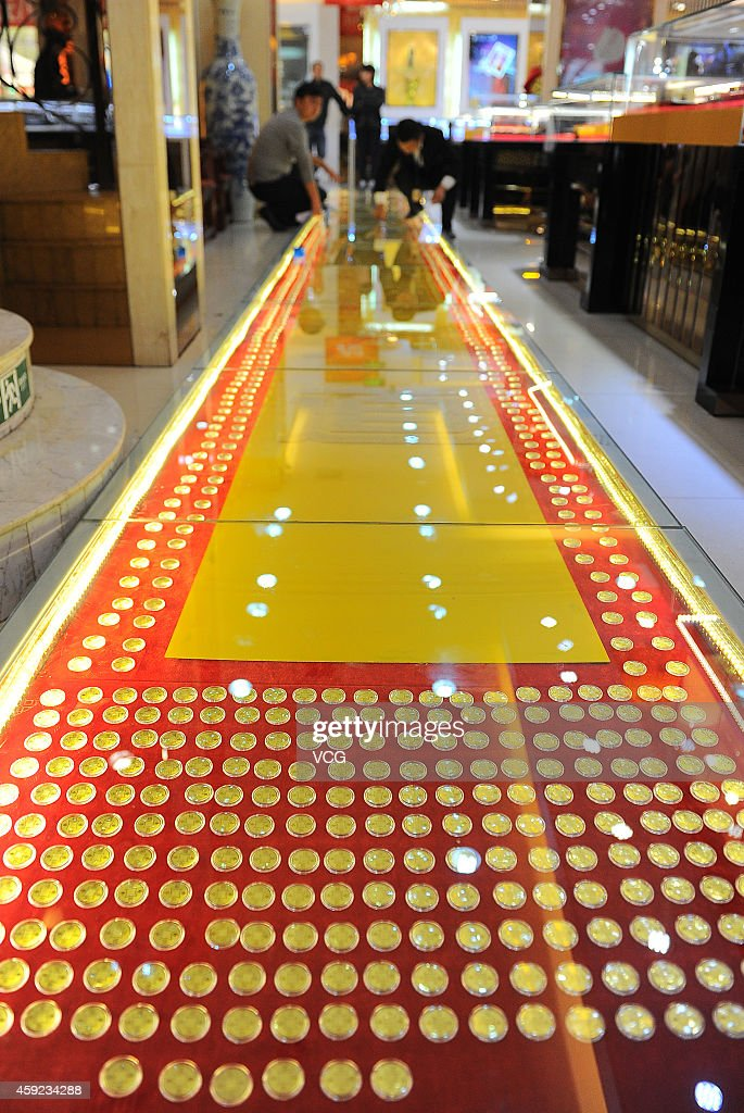 A general view of twelve-meter-long golden road on November 19, 2014 in Taiyuan, Shanxi province of China. A jewelry shop paved a twelve-meter-long road with gold coins during its upcoming shop celebration at the shopping mall to attract consumers.