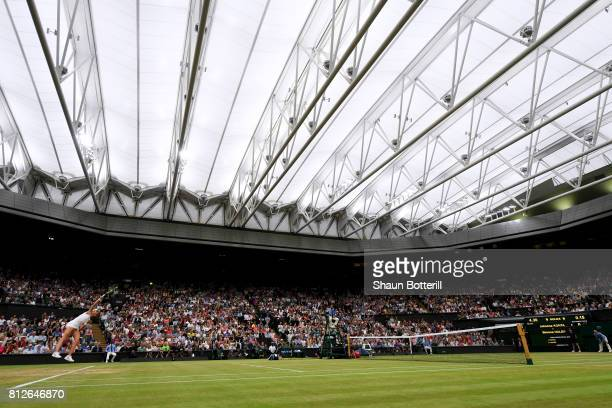 A general view of under the centre court roof as Johanna Konta of Great Britain serves during the Ladies Singles quarter final match against Simona...