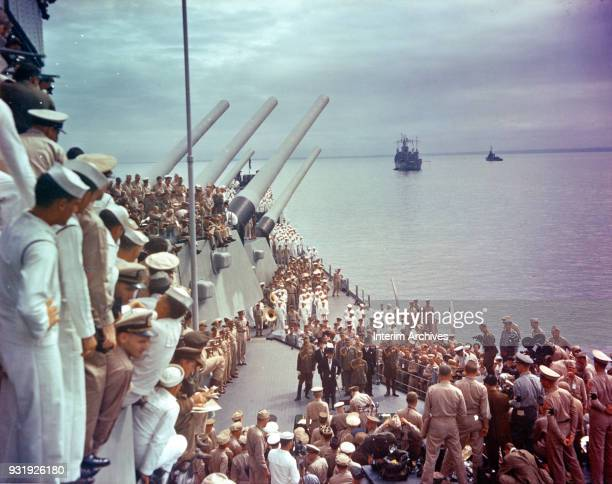 General view of US sailors as they watch the signing of the Japanese Instrument of Surrender on the deck of the USS Missouri, anchored in Tokyo Bay,...
