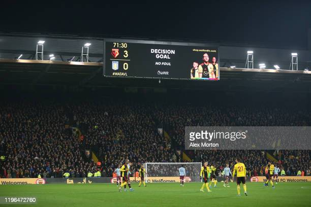 General view of Vicarage Road scoreboard displaying VAR decision during the Premier League match between Watford FC and Aston Villa at Vicarage Road...