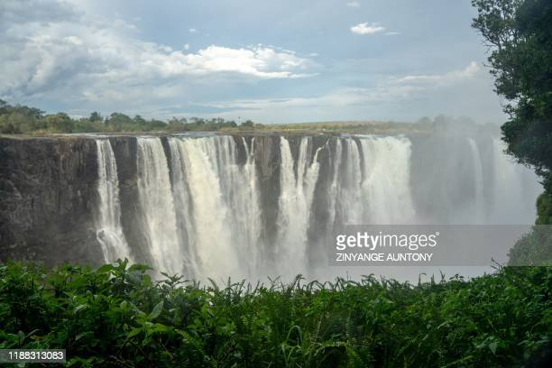 General view of Victoria Falls, in Zimbabwe, on December 10, 2019. - The Victoria Falls, a UNESCO world heritage site measuring 108 metres high and...
