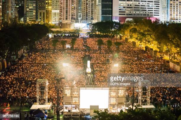 General view of Victoria park during the vigil service. Hundreds of thousands of Hong Kong people attended the annual candlelight vigil service in...