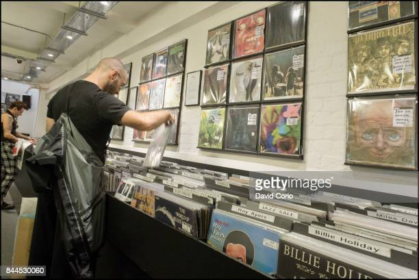General view of vinyl albums and CDs in the window of Sister Ray record shop Berwick Street Soho London UK on 4 September 2017