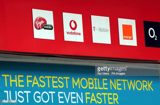 General view of Virgin Mobile Vodafone T Mobile Orange and O2 phone company logos on a phone shop in Birmingham