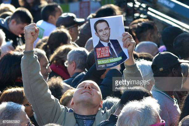 A general view of voters holding signs as French Socialist Party Presidential candidate Benoit Hamon addresses voters during a political meeting...