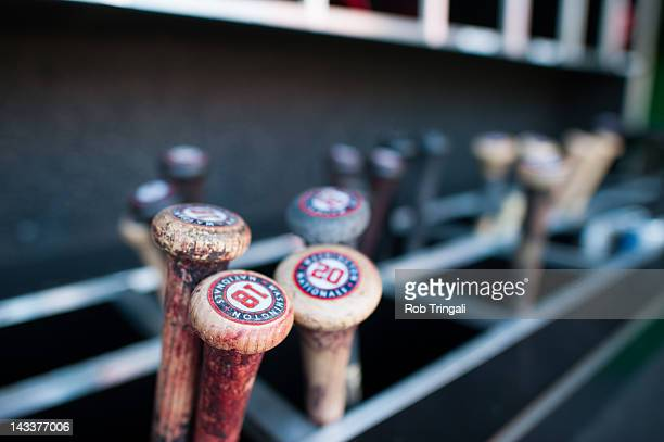 A general view of Washington Nationals bats in the bat rack in the dugout during the game against the Cincinnati Reds at Nationals Park on April 12...