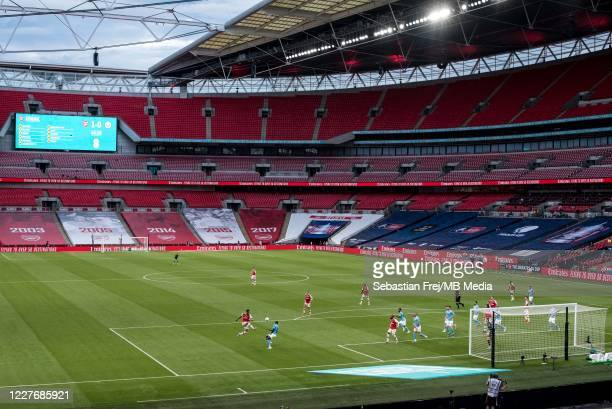 A general view of Wembley Stadium and PierreEmerick Aubameyang of Arsenal and Benjamin Mendy of Manchester City in action during the FA Cup Semi...