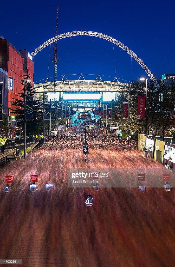 A general view of Wembley Stadium looking down Wembley Way as people make their way out of the stadium after the FA cup Semi Final between Arsenal and Reading at Wembley Stadium on April 18, 2015 in London, England.