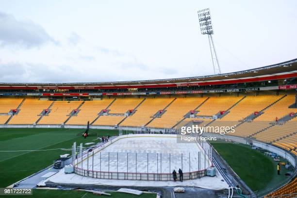 Fans look as officials assess a collapsed wall on the rink on prior to the cancellation of the Ice Hockey Classic between the United States of...