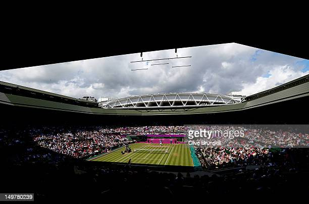 A general view of Wimbledon is seen as Juan Martin Del Potro of Argentina returns a shot against Roger Federer of Switzerland in the Semifinal of...
