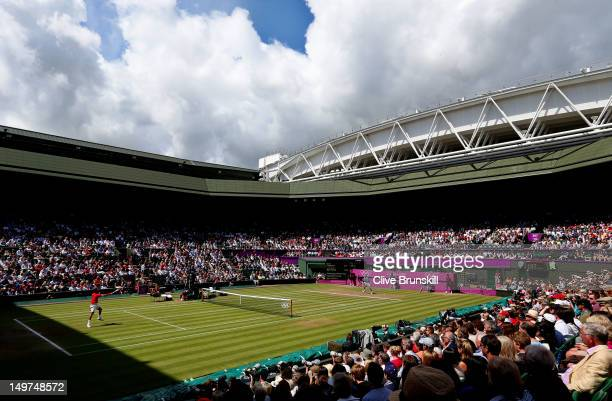 General view of Wimbledon is seen as Roger Federer of Switzerland returns a shot against Juan Martin Del Potro of Argentina in the Semifinal of Men's...