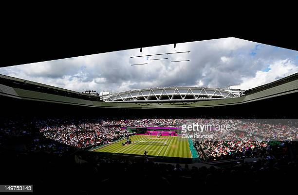 A general view of Wimbledon is seen as Roger Federer of Switzerland returns a shot against Juan Martin Del Potro of Argentina in the Semifinal of...