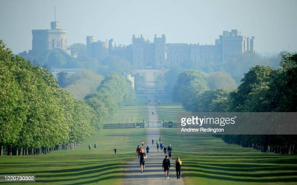 General view of Windsor Castle as people exercise on The Long Walk on April 24, 2020 in Windsor, England. The British government has extended the...