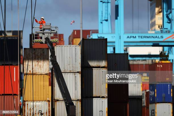 A general view of workers in the yard working on shipping containers and the cranes which move them at the Port of Rotterdam on October 27 2017 in...