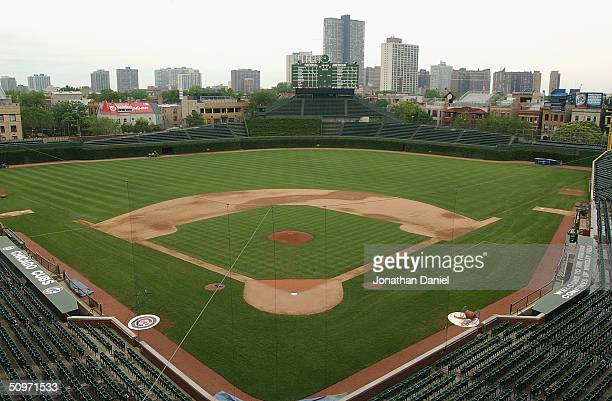 A general view of Wrigley Field and the Chicago skyline on June 15 2004 in Chicago Illinois Wrigley Field was built in 1914 and is the secondoldest...