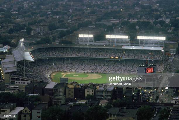 General view of Wrigley Field taken at night with the lights on in a game during the 1988 season in Chicago, Illinois.
