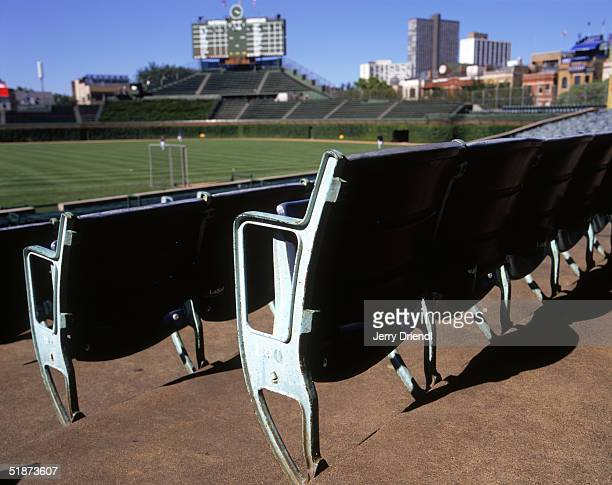 General view of Wrigley Field's field level seats with the center field scoreboard in the background prior to a game between the Philadelphia...