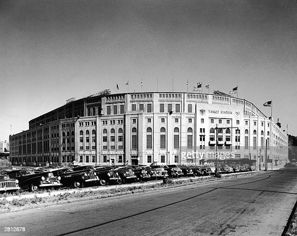 General view of Yankee Stadium and the parking lot in front filled to capacity, circa 1950.