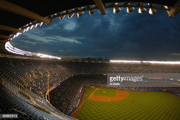 A general view of Yankee Stadium at night taken during the game between the New York Yankees and the Baltimore Orioles on June 1 2004 at Yankee...