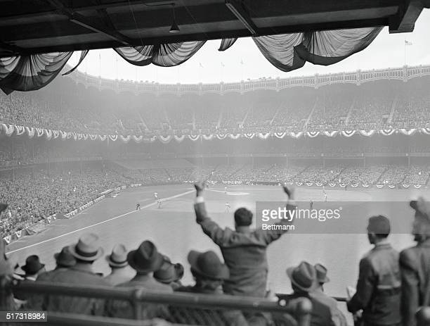 General view of Yankee Stadium, New York, showing part of packed grandstands and playing field, as New York edged Cincinnati, 2-1, in opening game of...