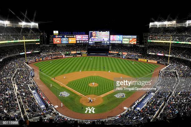 A general view of Yankee Stadium shot with a wide angle lens from the upper deck at night during a game between the New York Yankees and the...